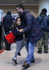 A man reacts as he meet his daughter who is a passenger of a flight from the Egyptian resort of Hurghada at Domodedovo Airport outside Moscow