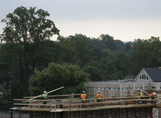 Construction workers erect framing on concrete towers for the new Silver Spring Library in Maryland