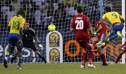 Gabon's Emerick shoots to score against Morocco during their African Cup of Nations soccer match in Libreville