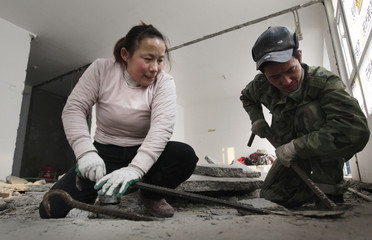 Deng Qiyan and her husband Cheng Jun work at a home renovation site in Beijing