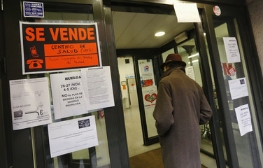 A man enters a public outpatient medical clinic during a 48-hour strike in Madrid