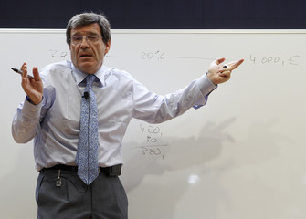 Martinez, chairman of Loterias, or LAE, gestures during a news conference in Madrid