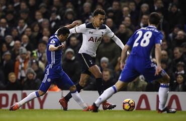 Tottenham's Dele Alli in action with Chelsea's Pedro