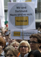 Anti-neo-Nazi protestors hold a placard during a left-wing demonstration in Dortmund