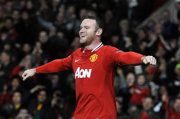 Manchester United's Rooney celebrates scoring against Athletic Bilbao during their Europa League soccer match in Manchester