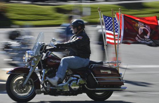 A motorcycle rider flies the American and POW-MIA flags as he rides with hundreds of thousands of fellow motorcyclists in Fairfax