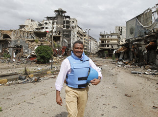 Yacoub El Hillo, a United Nations representative in Syria, reacts to the camera in old Homs city