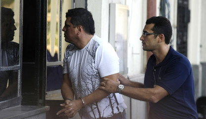 Colombian drug trafficker Ramon Caro-Chaparro arrives at the Brazilian Federal Police building after his arrest at Copacabana beach in Rio de Janeiro
