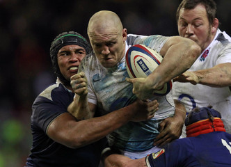 England's Mike Tindall is tackled by France's Thierry Dusatoir  during their Six Nations rugby union match in London