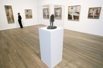 """Holden of the Tate poses with all six paintings of Edvard Munch's """"Weeping Woman"""" series, and a sculpture with the same name, at the Tate Modern in London's Southbank"""