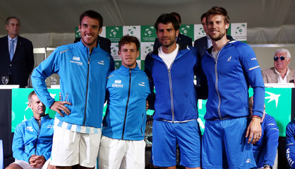 Argentina's Mayer and Schwartzman and Italy's Bolelli and Seppi pose for a picture during the official draw of their upcoming Davis Cup tennis match in Buenos Aires