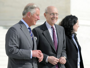 Prince Charles of Britain exits the U.S. Supreme Court with Justice Stephen Breyer after a reception for the Marshall scholarship alumni in Washington