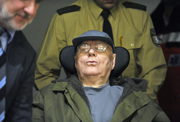Accused Nazi death camp guard Demjanjuk arrives in a court room for continuation of trial in Munich