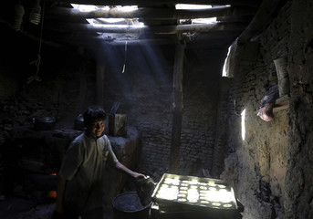 A man prepares special sweets at a small traditional factory ahead of the holy month of Ramadan in Kabul