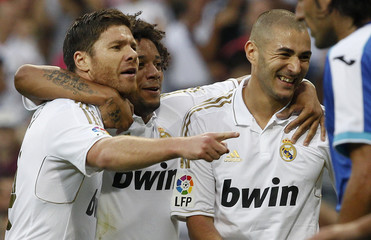 Real Madrid's Benzema celebrates his goal against Getafe with teammates Marcelo and Alonso during their Spanish first division soccer match in Madrid