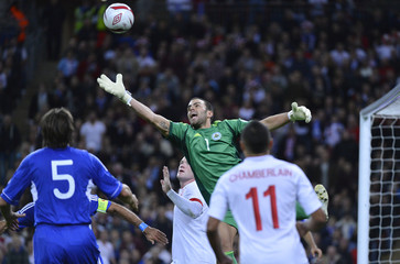 San Marino's goalkeeper Aldo Simoncini saves a shot during their 2014 World Cup qualifying soccer match against England at Wembley Stadium in London
