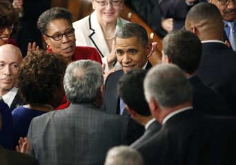 U.S. President Barack Obama greets members of a joint session of Congress prior to his State of the Union Speech in Washington