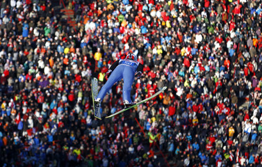 Switzerland's Ammann soars over thousands of spectators to take the fourth place in the third event of the  Four-Hills ski jumping tournament in Innsbruck