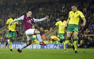 Ross McCormack of Aston Villa and Ryan Bennett of Norwich City in action