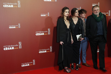 French journalist and writer Denis Robert, and Nina Robert pose with guest as they arrive at the 41st Cesar Awards ceremony in Paris