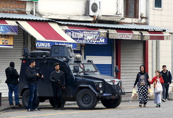 Police take security measures during an operation in Sur district, where an unidentified gunman on Saturday killed a top Kurdish lawyer, in the Kurdish-dominated city of Diyarbakir