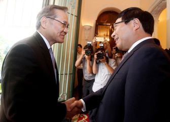 Thai FM Don Pramudwinai is greeted by Vietnam's DPM and FM Minh at the Govenment Guesthouse in Hanoi, Vietnam