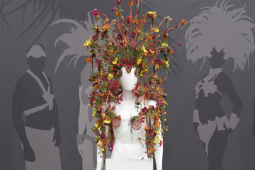 A floral design for a hat is seen on a mannequin at the Chelsea Flower Show in London, Britain