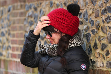 A woman reacts outside the house of singer George Michael, where he died on Christmas Day, in Goring, southern England