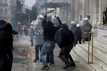 Demonstrators clash with riot police during a 24-hour general strike against the latest round of austerity in Athens
