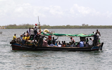 Traders sail on a traditional boat in Lamu, near the beach home of a French woman who was kidnapped and held hostage