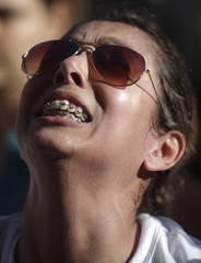 A woman reacts during a protest against the deaths from the fire at the Boate Kiss nightclub, in the southern city of Santa Maria