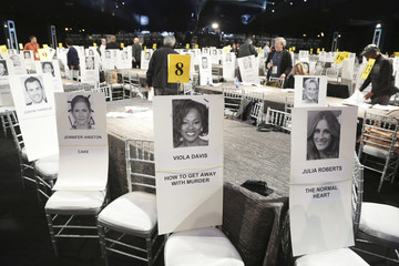 Photos are pictured on seats indicating where celebrities will be seated during tomorrow's SAG Awards at the Shrine Auditorium in Los Angeles