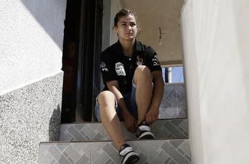 Olympic judo hopeful Majlinda Kelmendi of Kosovo sits at home in her hometown of Peja