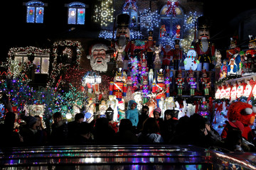 People walk by at the Dyker Heights Christmas Lights in the Dyker Heights neighborhood of Brooklyn, New York City, U.S.