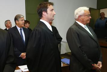 Former Deutsche Bank Chief Executive Breuer, lawyer Scharf, former CEO Ackermann, current co-CEO Fitschen await the start of their trial in a courtroom in Munich