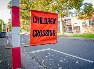"""An Australian """"Children Crossing"""" signpost outside a school in Melbourne Australia"""