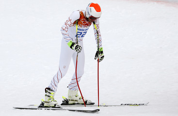Miller of the U.S. leans on his ski poles after the downhill run of the men's alpine skiing super combined training session at the 2014 Sochi Winter Olympics