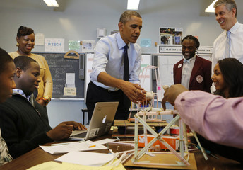 U.S. President Barack Obama helps with a project in a math class at a high school in Brooklyn