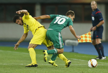 Rapid Wien's Schaub and Villarreal's Jokic fight for the ball during their Europa league soccer match in Vienna