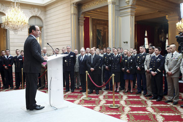 """France's President Francois Hollande gives a speech where he declared """"mission accomplished"""" during a ceremony to honour French troops at the Elysee Palace in Paris"""