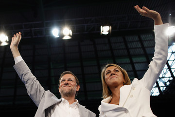 Spain's main opposition Popular Party leader Rajoy and Secretary-General de Cospedal wave the audience after De Cospedal delivered her speech during their Popular Party's national convention in Malaga