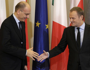 Poland's Prime Minister Tusk welcomes his Italian counterpart Letta as they meet in Warsaw
