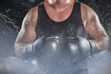 Composite image of mid section of muscular boxer