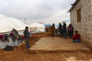 Syrian refugee children play at the Bab Al-Salam refugee camp in Azaz, near the Syrian-Turkish border