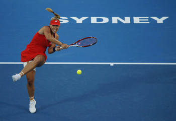 Kerber of Germany plays a forehand return to Pironkova of Bulgaria during their women's singles final match at the Sydney International tennis tournament