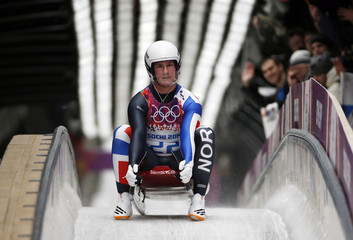 Norway's Toennes Stang Rolfsen comes to a stop after a run in the men's singles luge competition at the 2014 Sochi Winter Olympics