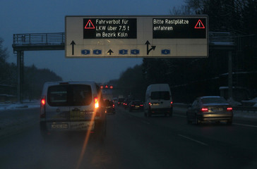 """A sign on the A3 motorway near Cologne reads, """"Driving ban for trucks over 7.5 tons in the Cologne region"""" during early morning hours"""