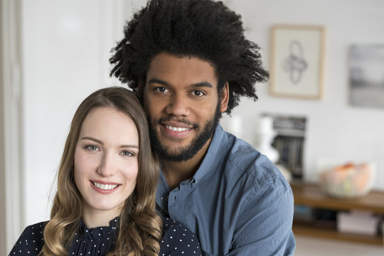 Portrait of smiling couple looking in camera