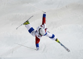 Russia's Sergey Volkov crashes during men's freestyle skiing moguls qualification round at 2014 Sochi Winter Olympic Games in Rosa Khutor
