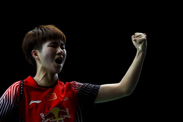 China's Yun reacts during the badminton match against U.S. Schafer at the Brasil Open badminton competition at the Riocentro convention centre in Rio de Janeiro